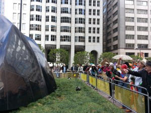 "St. Stupid's Day marchers throw pennies at the sculpture ""Transcendence,"" also known as the ""Banker's Heart,"" outside of 555 California St. Photo: Zack Farmer"