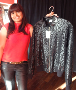 Sabah holds a bomber jacket at the Mansoor Scott Trunk show.
