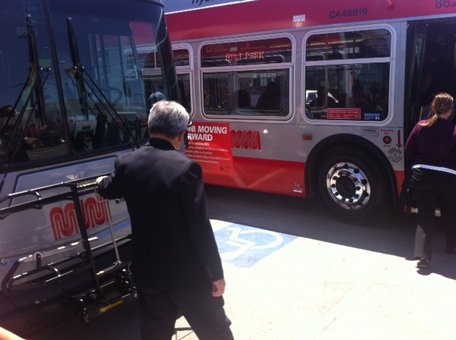 Mayor Lee stands outside a malfunctioning bus at a Muni  event today meant to unveil new hybrid buses. Photo: Dan McMenamin