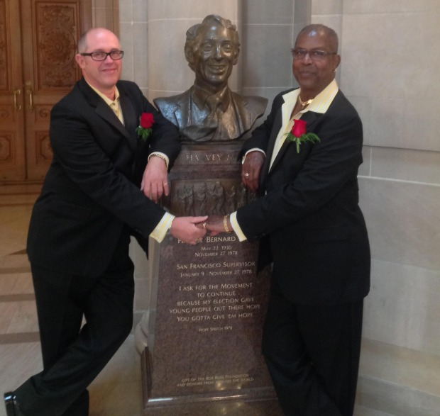 James Wright and Albert Patterson, who got married at San Francisco City Hall on 11-12-13, pose in front of a bust of Harvey Milk.  PHOTO BY RON SCHAER, COURTESY OF WRIGHT AND PATTERSON