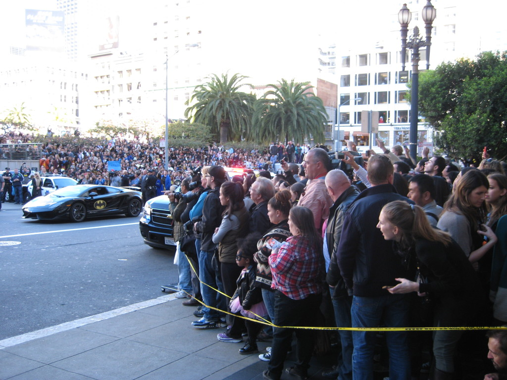 Crowds watch as Batkid heads off in the Batmobile to rescue Lou  Seal from the Penguin at AT&T Park. PHOTO BY MELISSA MCROBBIE