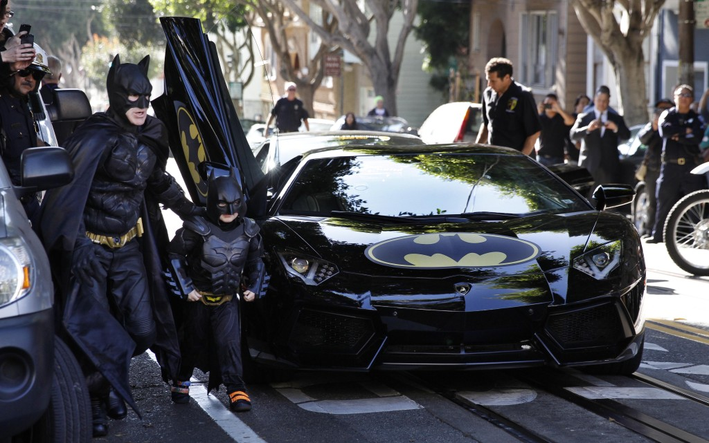 "Five-years-old Miles, from Tule Lake, Calif., is dressed in a Batman costume in San Francisco, Friday, November 15, 2014. Miles, who wants to be a Batman, will embark on a series of crime-solving adventures when San Francisco is converted into ""Gotham City"" as part of a Make-A-Wish Foundation event. He is in a fight on his own in his battle against leukemia since he was a year old. He is now in remission. (Photo: Make-A-Wish Foundation/PaulSakuma.com)"